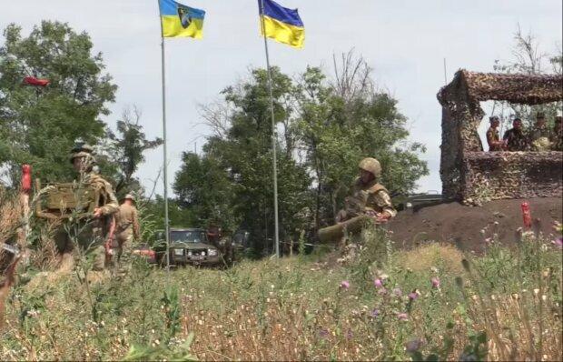 Військові на Донбасі, скріншот із відео