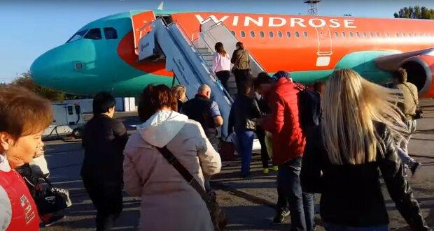 посадка в літак